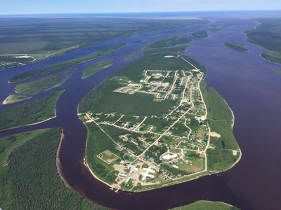 Aerial shot of Moose Factory showing the roads and buildings surrounded by the water