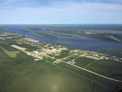 Aerial of Moosonee showing the town in the foreground and the water and islands behind